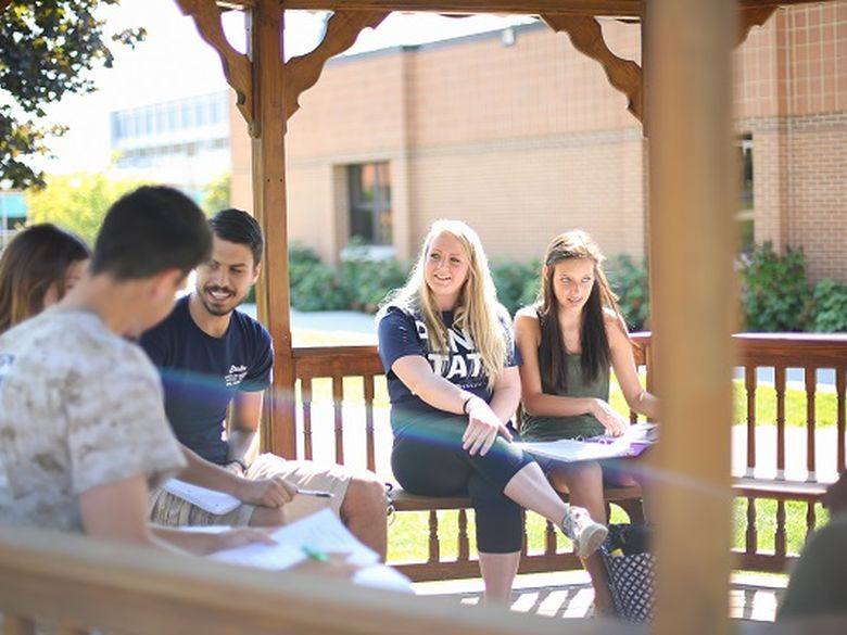 students sitting in gazebo