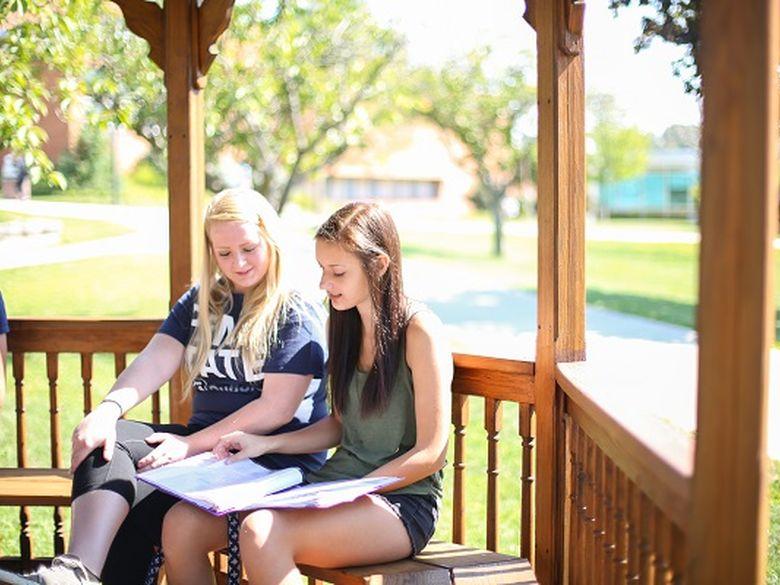 students sitting on gazebo at Penn State DuBois
