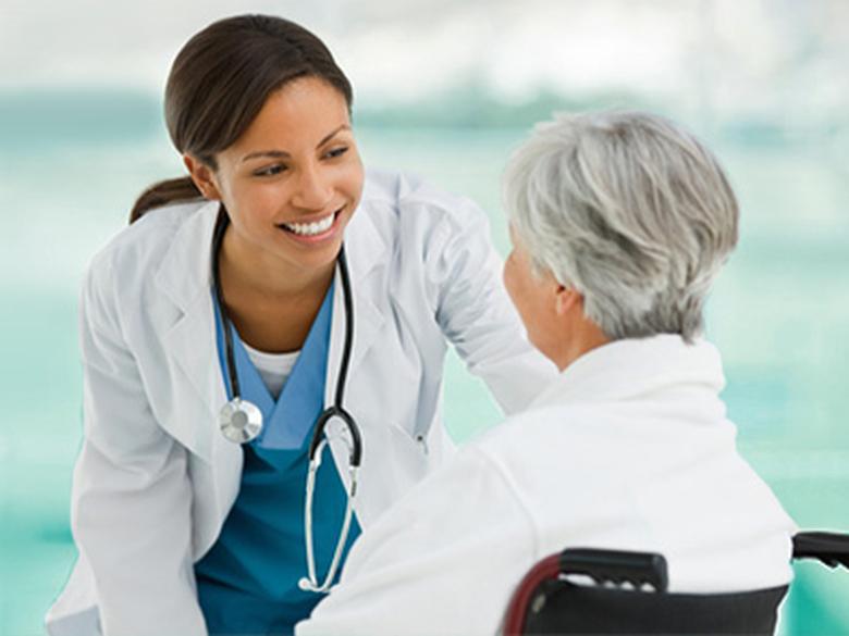 Dark haired women, healthcare worker with eldery women