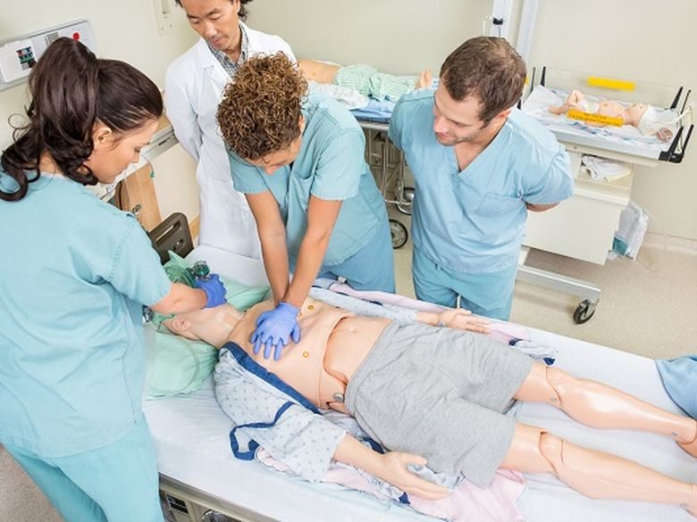 picture of nurses and medical staff in a classroom sim lab