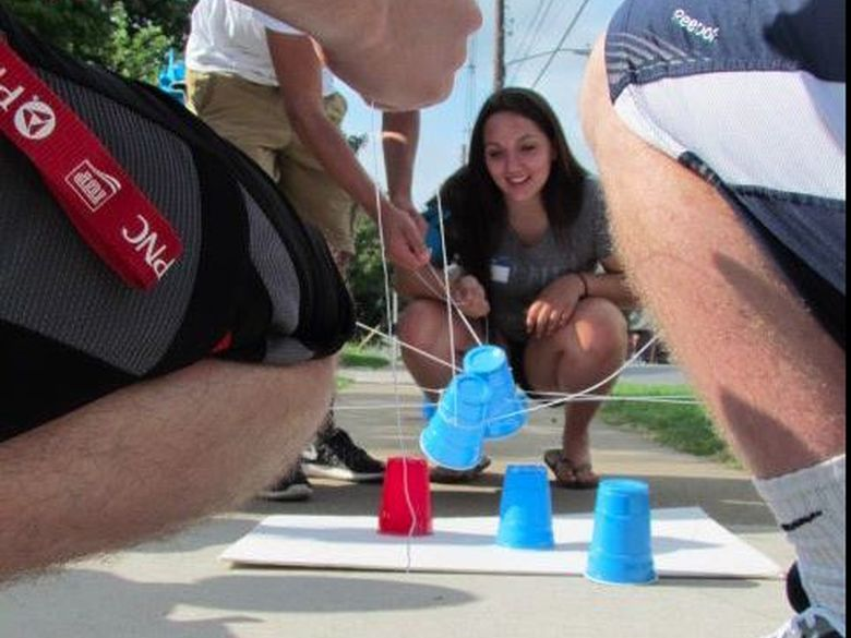 Students playing a game with cups