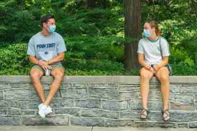 Two students socially distanced wearing masks