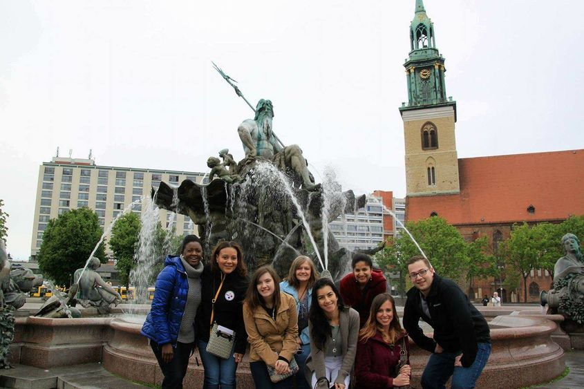 The group captured this photo at Neptune Fountain, in front of Rotes Rathaus (the city hall in Berlin).